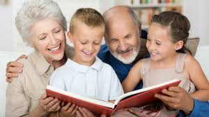 children reading with grandparents