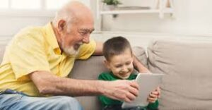 teens with grandparents playing on a tablet
